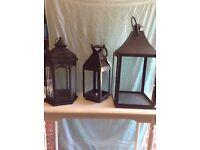 Three large garden lanterns