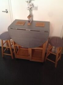 Compact table and stools