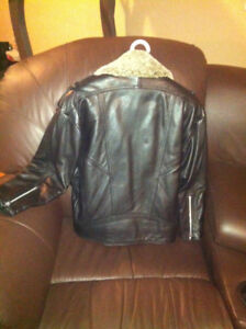 Women's Leather jacket size small, brand new. custom made