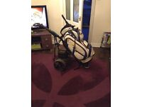 Stowamatic electric golf trolley and Powercaddy trolley bag.