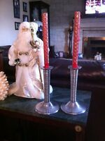 2 candle sticks holders with red Christmas candles