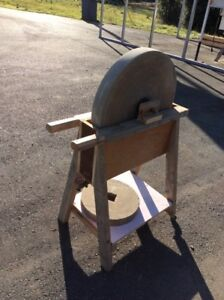Antique grinding wheel with stand.