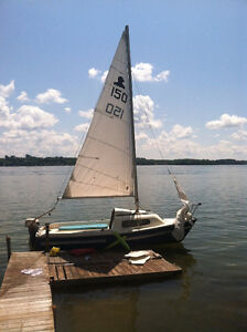 16FT SAILBOATWITH  6 HPJOHNSON OUTBOARD AND TRAILER