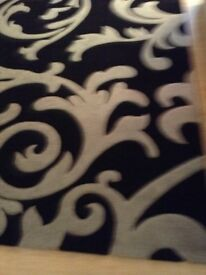 VERY LARGE BLACK AND GREY RUG