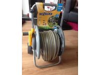 New Hozelock 30metre hose with holder reel and all attachments rrp £55