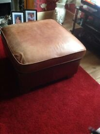 Brown leather storage puffy