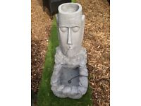 Solar powered Easter Island Head water feature with LEDs