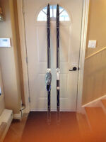Cross country skis and leather boots in excellent condition