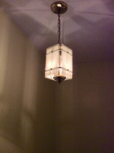 Elegant Chandelier with Frosted Glass Shades