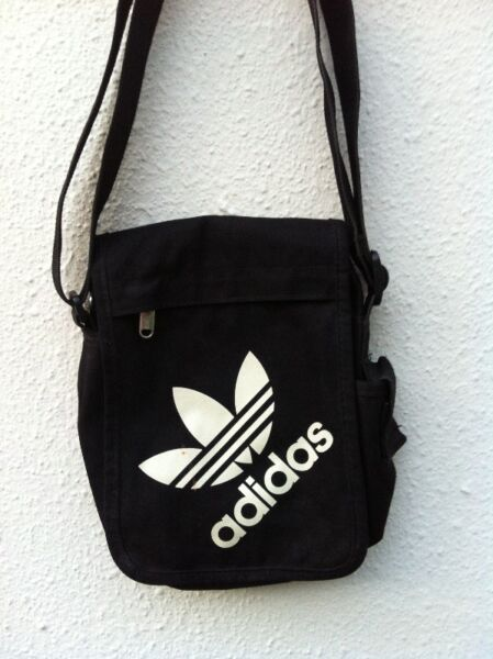 Adidas black pouch sling bag. In good condition. Dimension 17 x 20 x 5cm.