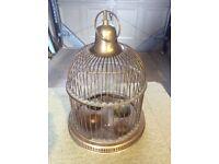 Antique brass hanging bird cage.