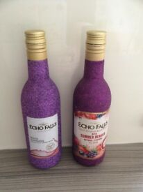 Two EMPTY purple glittery bottles