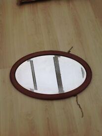 Vintage oval hardwood mirror
