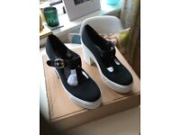 New black and white wedge shoes in a size 7 from Schuh .