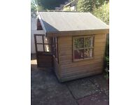Lovely wooden garden playhouse