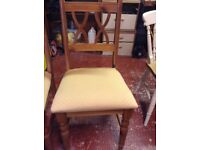 Two wooden pad seat chairs