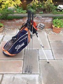 Set of ping irons with titleist carry bag