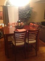 Pub style dining table with 8 chairs