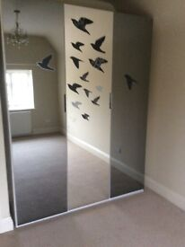 Large triple wardrobe with mirrored doors