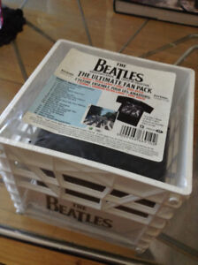 Beatles CD milk crate, Abbey Road CD and t-shirt.