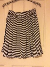 Pretty black and white stripy pleated skirt size 10