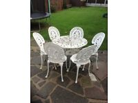 CAST ALUMINIUM GARDEN TABLE AND 6 CHAIRS