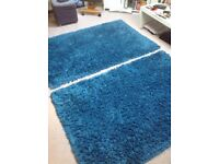 Two teal rugs
