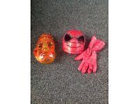 Pair solid plastic superhero masks.