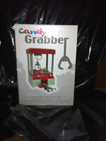 ELECTRONIC CANDY GRABBER NEW IN BOX