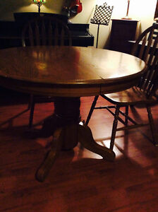 Solid Oak Pedestal Table with extra Leaf & Two matching Chairs