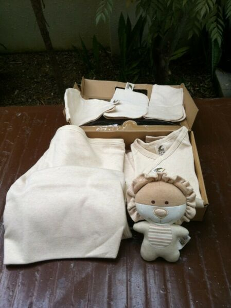 Delphi baby gift set.  Comprise one jumpsuit, one blanket, one toy and three napkins.