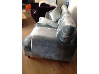 Soft grey velvet sofa and footstool
