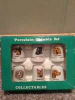 Collectible glass thimble set (6) of dogs.
