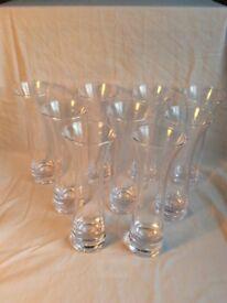 "9 🌺 glass flower vases , 8"" £20ono"