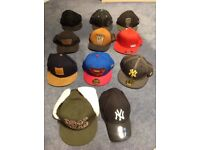 Vans and various baseball caps