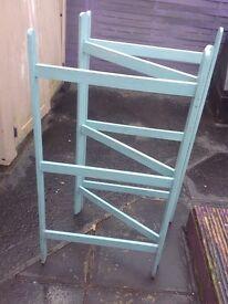 Blue wooden clothes horse
