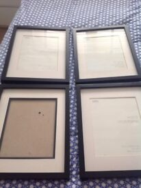 16 photo frames in various sizes and colours