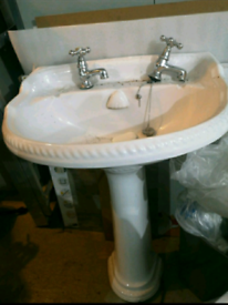 Old Ceramic Bathroom Sink on Pedestal. Outdoor contact-free viewing w