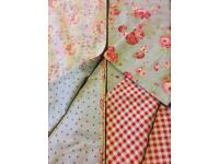 Two Ikea lamps matching Ikea floral Cath kidston fabric single duvets.
