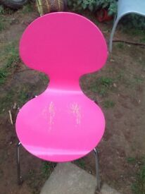 Two pink chairs