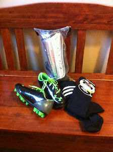 Child's soccer shoes, shinpads, socks