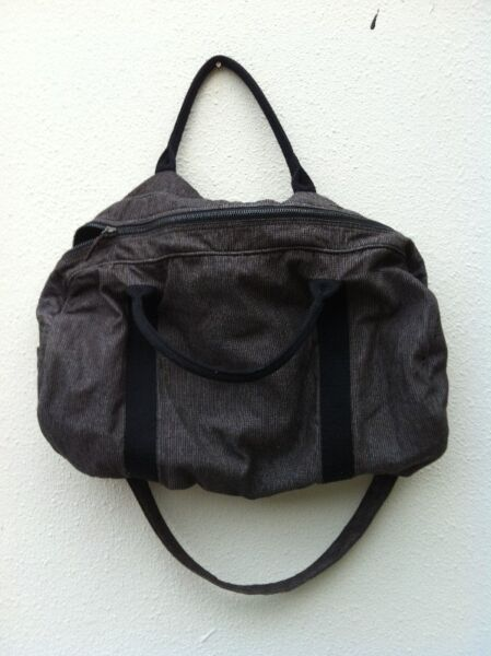 Grey fabric bag. Dimension 60 x 35 x 18cm. In good condition.