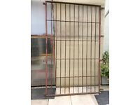 Large wrought iron window panel grill