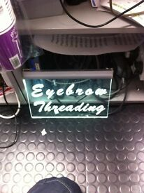 Light up eyebrow sign