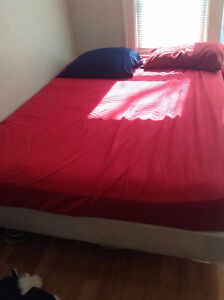 Queen size bed with mattress and bed frame