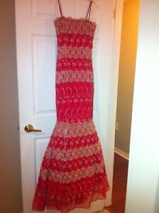 Red and gold evening dress looks much  better than the picture