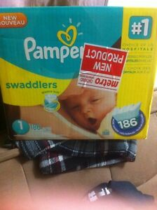 Size 1 un open box of pampers asking $25