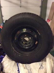 BF Goodrich Slalom winter tires on rim - 265 70R17