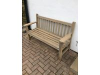 Wooden garden bench approximately 5 feet in length