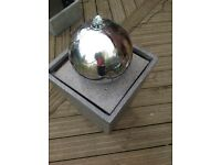 Tapered stone effect column water feature with stainless steel sphere and LED light